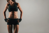 Athletic woman with strong abdominal muscles