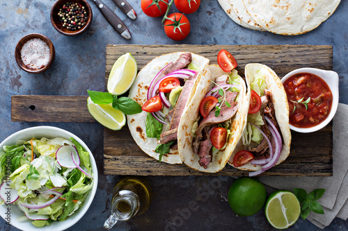Fotografie, Obraz  Steak tacos with sliced meet, salad and tomato salsa