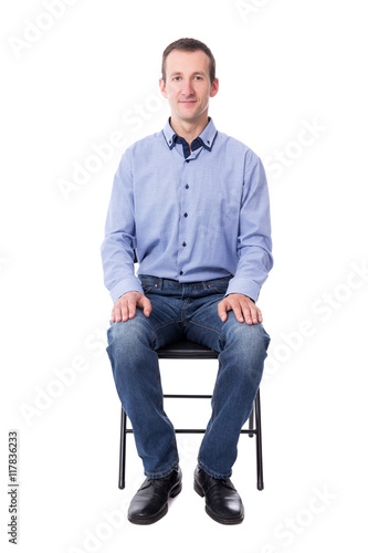young man sitting on office chair isolated on white