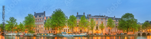 Valokuva  Panoramic view and cityscape of Amsterdam with boats, old buildings and Amstel r