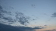 Timelapse of clouds in the sky during a sunset.