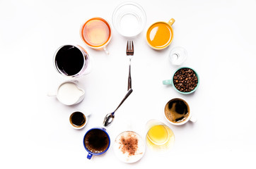 Fototapeta Do herbaciarni Cups with liquids like a coffee, milk, wine, alcohol, juice stacked in a circle. Clock consist of twelve cups. Time. Alarm clock. Beverages.