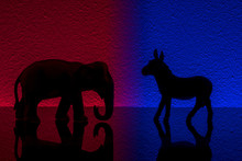Democrats Vs Republicans Are Facing Off In A Ideological Duel On Blue And Red Backgrounds. In American Politics US Parties Are Represented By Either The Democrat Donkey Or Republican Elephant