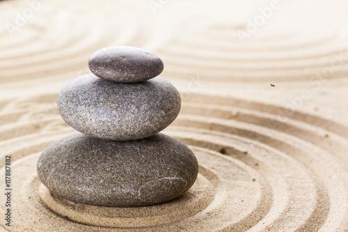 Photo Stands Stones in Sand zen garden meditation stone background