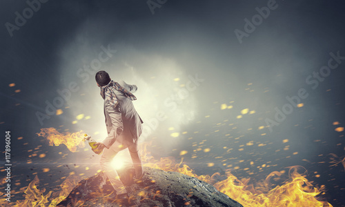 Photo Businessman throwing petrol bomb . Mixed media