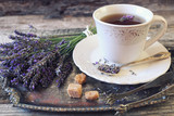 Fototapeta Lavender - Аromatic lavender tea and bunch of lavender