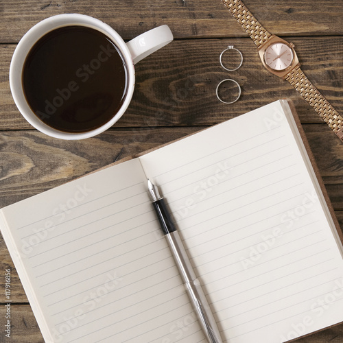 Aerial Shot Of A Writers Notebook And Pen With A Cup Of Coffee On A