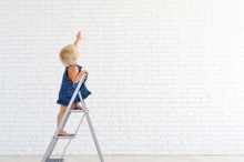 Girl On The Ladder