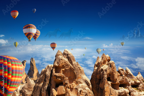 Hot air balloons, hand carved rooms in rocks, two running horses