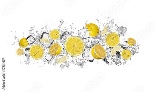Lemon in water splash on white background