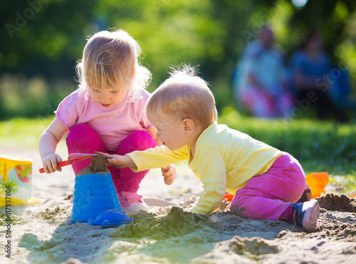 Fotografie, Obraz  Two children playing in sandbox