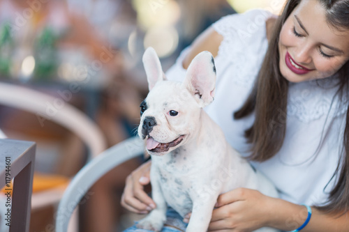 Beautiful Young Girl Holding Adorable White French Bulldog Puppy In