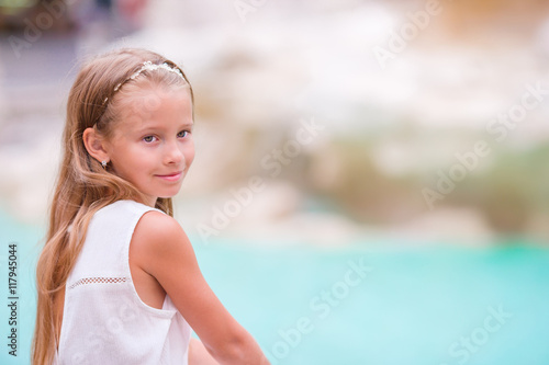 f58be8a3 Adorable little girl background Trevi Fountain, Rome, Italy. Happy toodler  kid enjoy italian