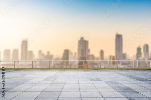 Fototapeta  empty roof top with cityscape background