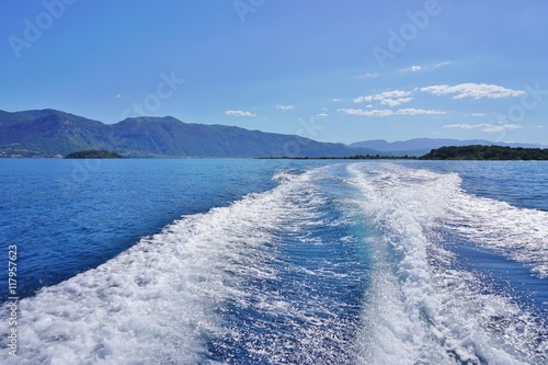 Fotografie, Obraz  Boat wake on the blue sea in the Greek islands