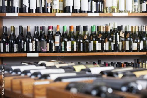 Photo Wine Bottles Displayed On Shelves