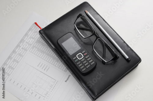 The Document Of The Report Glass Phone And Pen On Notebook  Buy  The Document Of The Report Glass Phone And Pen On Notebook
