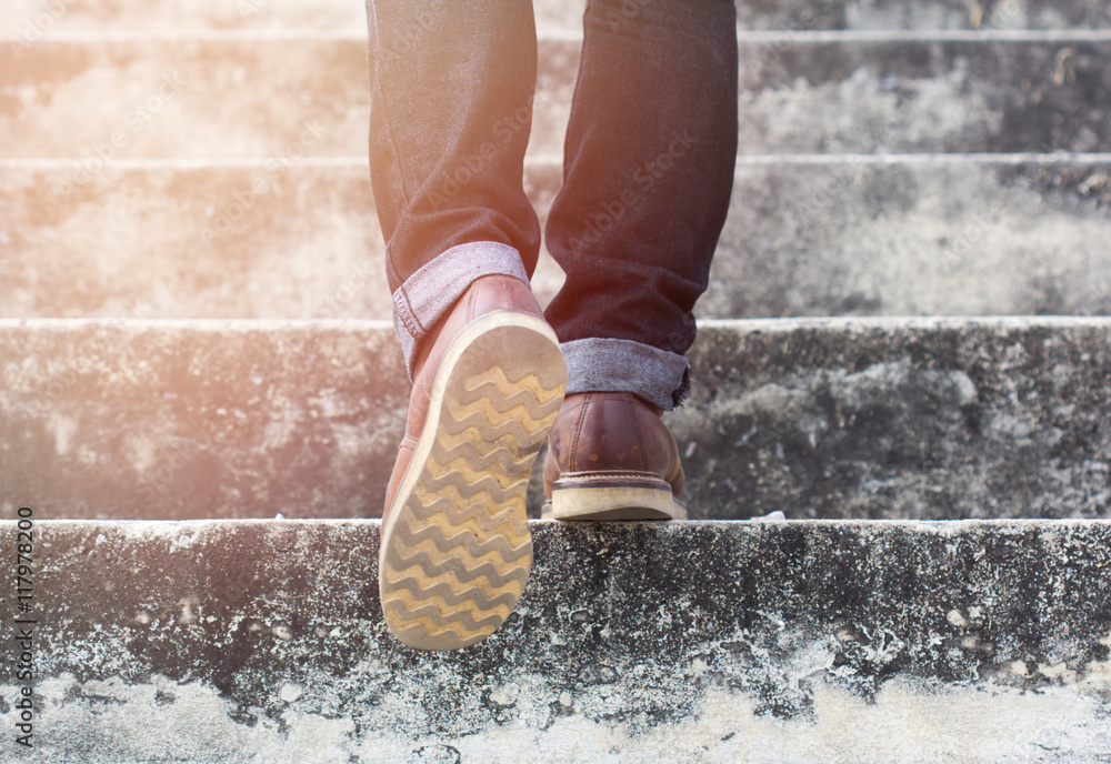 Fototapeta a man with blue geans and  sneaker shoes in stair