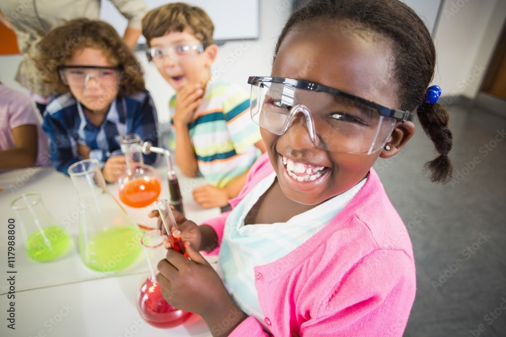 Fototapety, obrazy: Kids doing a chemical experiment in laboratory