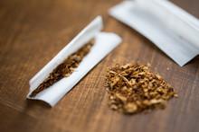 Close Up Of Marijuana Or Tobacco Cigarette Paper