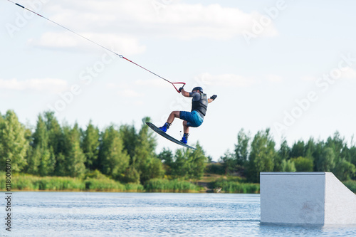 Man does wakeboarding sport.