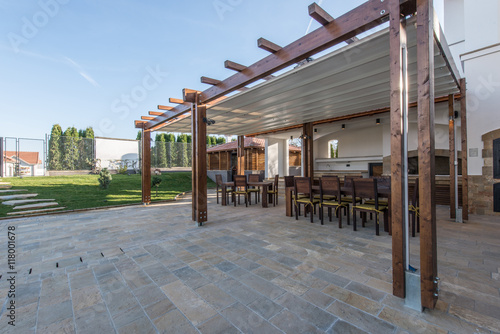 Cuadros en Lienzo Long table and chairs on veranda in luxury villa exterior