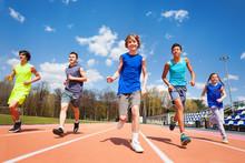 Five Happy Teenage Kids Running On The Stadium