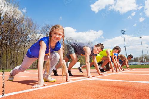 Fototapeta Group of teenage runners lined up ready to race obraz