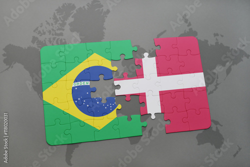 puzzle with the national flag of brazil and denmark on a world map background Poster