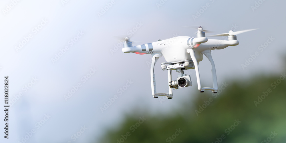 Fototapety, obrazy: Flying drone in action
