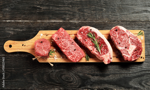 Photo Stands Meat Fresh raw Prime Black Angus beef steaks on wooden board