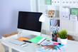 Designer working desk with computer and paperwork