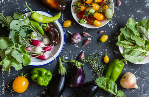 Fresh vegetables - radishes, eggplant, pepper, tomatoes, onion, garlic on a dark wooden background Poster