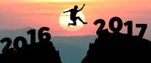 Silhouette Man Jumps To Make T...