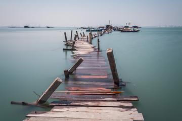 FototapetaWater overflow on a broken wooden bridge