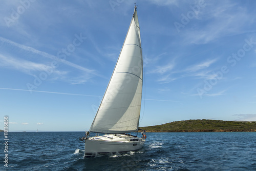 Fotografering  Sailing ship yachts with white sails in the Aegean Sea