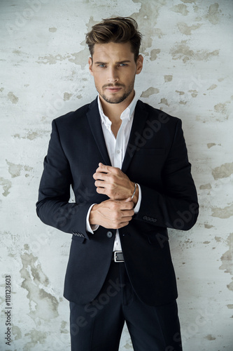 Fotografering  Portrait of sexy man in black suit