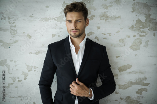 Foto auf Leinwand Friseur Portrait of sexy man in black suit
