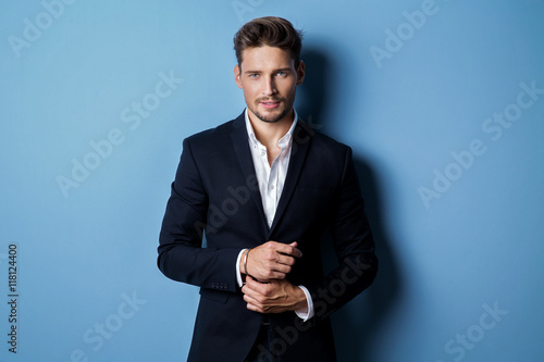 Handsome man wear black suit Fotobehang
