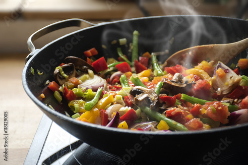 steaming mixed vegetables in the wok, asian style cooking