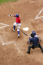 A Batter Takes A Big Swing And Gets A Hit