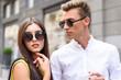 Pretty loving couple walking in town