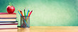 canvas print picture Apple On Stack Of Books With Pencils And Blank Chalkboard - Back To School