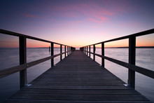Long Wooden Pier Into A Lake At Sunset, Perfect Symmetry
