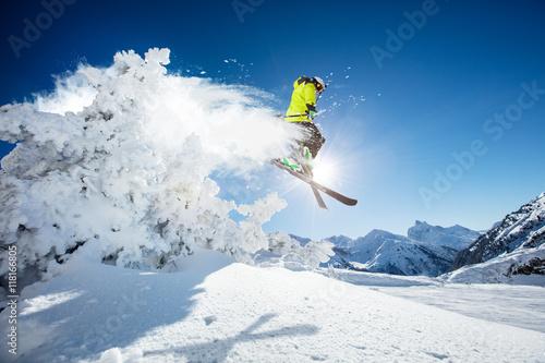 Obraz na plátně Skier at jump in Alpine mountains