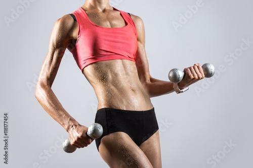 Posing sweaty bodybuilder