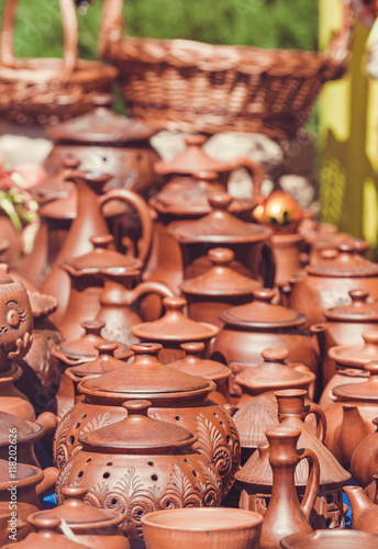 Aluminium Prints Old abandoned buildings Souvenir pottery on market stand outdoor