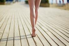 Closeup Of Beautiful Woman Leg's On Wooden Beach Jetty