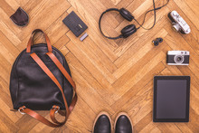 Top View On Hotography Stuff With Blank Tablet On Wooden Floor. Photographer Equipment On Wooden Floor. Flat Lay