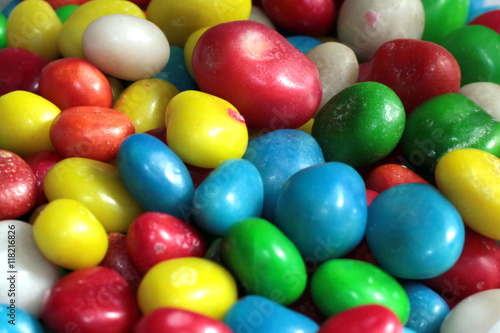 Poster Confiserie a heap of colorful round candy sugar pills